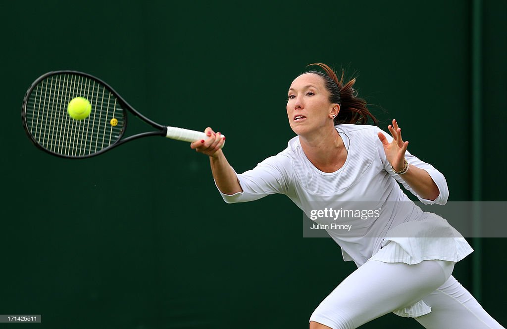 Jelena Jankovic of Serbia plays a forehand during her Ladies' Singles first round match against Johanna Konta of Great Britain on day one of the Wimbledon Lawn Tennis Championships at the All England Lawn Tennis and Croquet Club on June 24, 2013 in London, England.