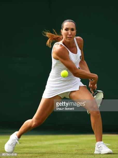 Jelena Jankovic of Serbia plays a forehand during the Ladies Singles first round match against Agnieszka Radwanska of Poland on day two of the...