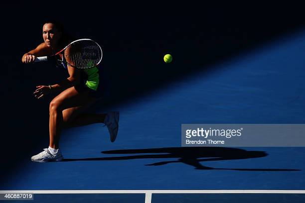 Jelena Jankovic of Serbia plays a forehand in her first round match against Ekaterina Makarova of Russia during day two of the Sydney International...