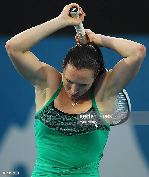 Jelena Jankovic of Serbia reacts after losing a point in her match against Aravane Rezai of France during day two of the 2011 Medibank International...