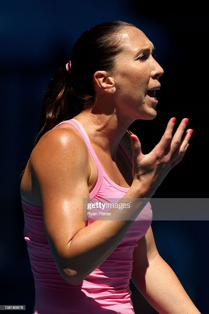 <a gi-track='captionPersonalityLinkClicked' href=/galleries/search?phrase=Jelena+Jankovic&family=editorial&specificpeople=217552 ng-click='$event.stopPropagation()'>Jelena Jankovic</a> of Serbia reacts in her second round match against Shuai Peng of China during day four of the 2011 Australian Open at Melbourne Park on January 20, 2011 in Melbourne, Australia.