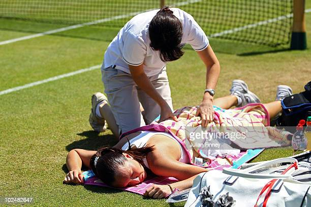 Jelena Jankovic of Serbia receives treatment during her match against Vera Zvonareva of Russia on Day Seven of the Wimbledon Lawn Tennis...