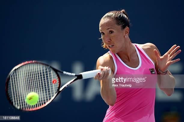 Jelena Jankovic of Serbia returns a shot against Agnieszka Radwanska of Poland during their women's singles third round match on Day Six of the 2012...