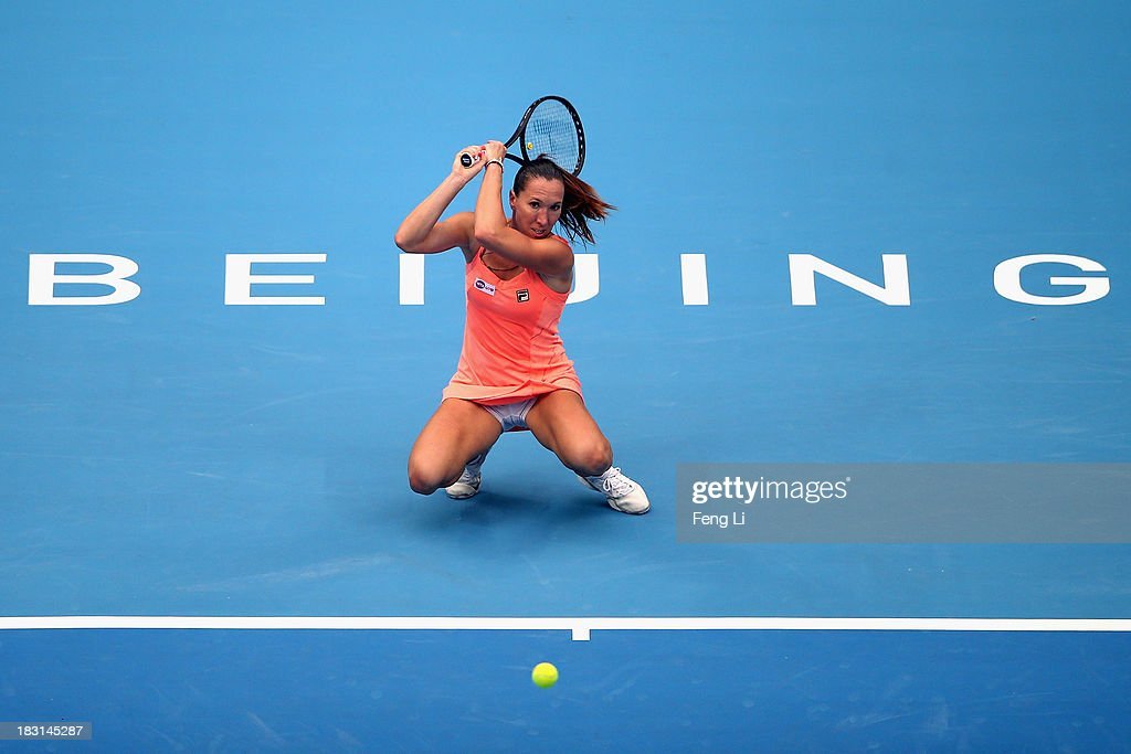 <a gi-track='captionPersonalityLinkClicked' href=/galleries/search?phrase=Jelena+Jankovic&family=editorial&specificpeople=217552 ng-click='$event.stopPropagation()'>Jelena Jankovic</a> of Serbia returns a shot during her women's semi-final match against Petra Kvitova of Czech Republic on day eight of the 2013 China Open at the National Tennis Center on October 5, 2013 in Beijing, China.