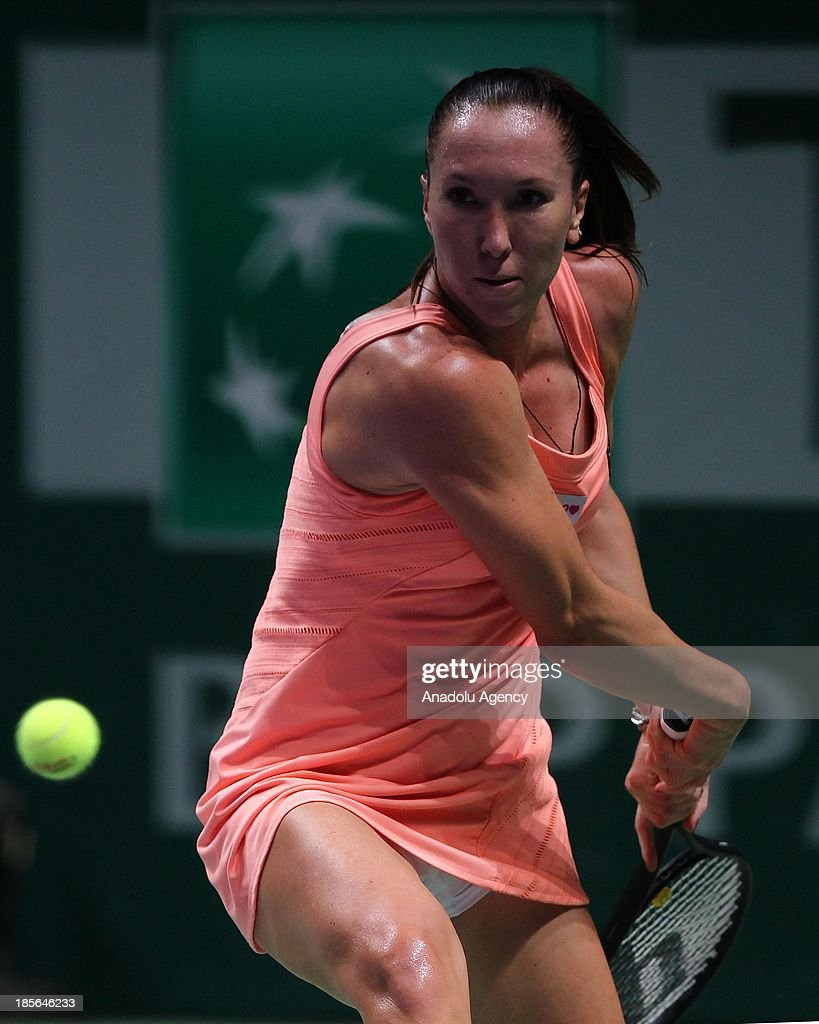 Jelena Jankovic of Serbia returns the ball to Victoria Azarenka of Belarus during their TEB BNP Paribas WTA Championships match at Sinan Erdem Dome on October 23, 2013 in Istanbul, Turkey.