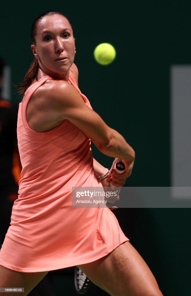 Jelena Jankovic of Serbia returns the ball to Victoria Azarenka of Belarus during their TEB BNP Paribas WTA Championships match at Sinan Erdem Dome on October 23, 2013 in Istanbul, Turkey.