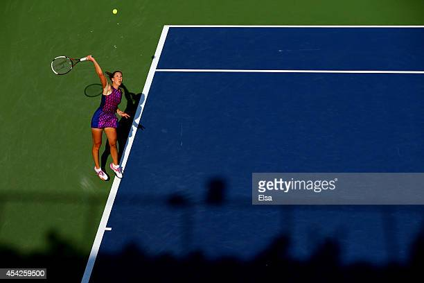 Jelena Jankovic of Serbia serves a shot against Tsvetana Pironkova of Bulgaria on Day Three of the 2014 US Open at the USTA Billie Jean King National...