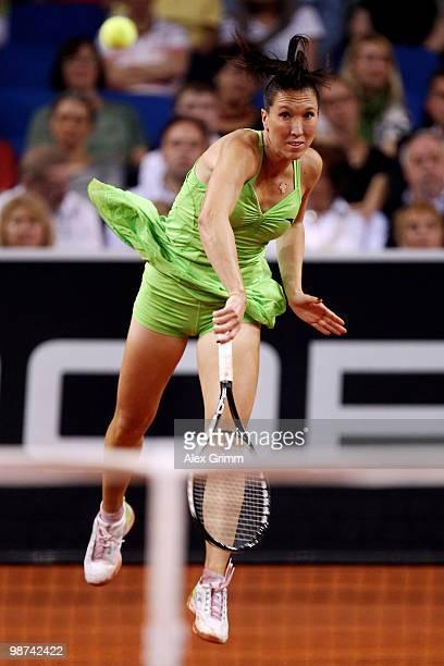 Jelena Jankovic of Serbia serves the ball during her second round match against Tsvetana Pironkova of Bulgaria at day four of the WTA Porsche Tennis...