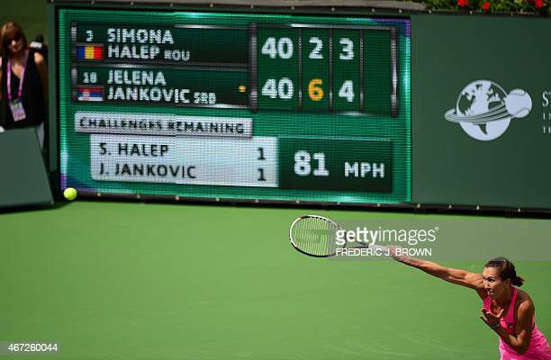 Jelena Jankovic of Serbia serves to Simona Halep of Romania during the women's final of the BNP Paribas Tennis Open in Indian Wells California on...