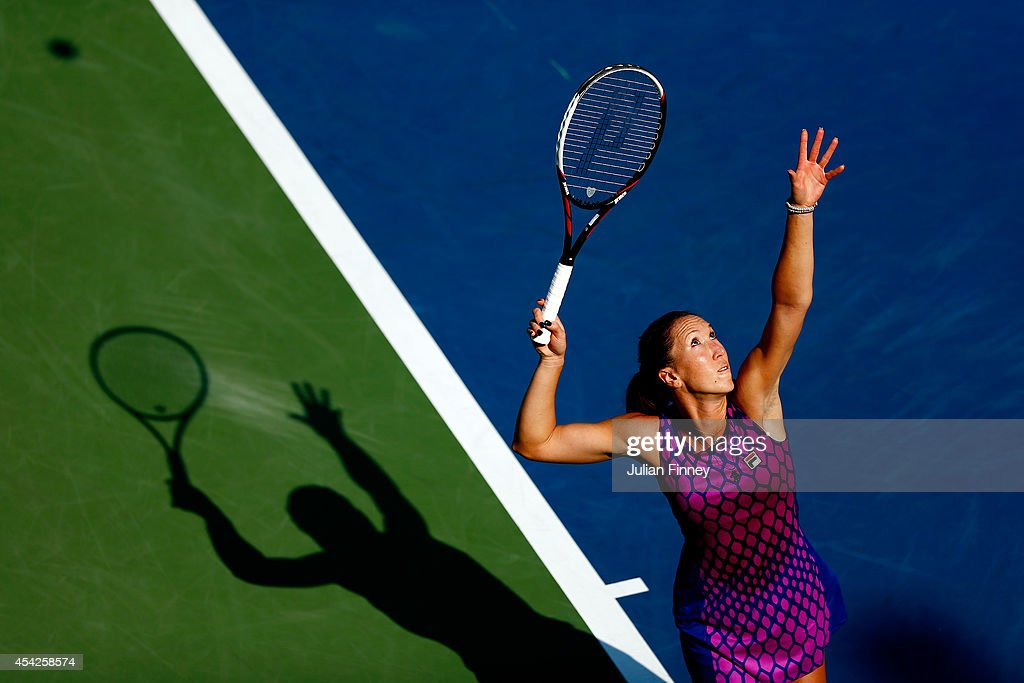 <a gi-track='captionPersonalityLinkClicked' href=/galleries/search?phrase=Jelena+Jankovic&family=editorial&specificpeople=217552 ng-click='$event.stopPropagation()'>Jelena Jankovic</a> of Serbia serves to Tsvetana Pironkova of Bulgaria on Day Three of the 2014 US Open at the USTA Billie Jean King National Tennis Center on August 27, 2014 in the Flushing neighborhood of the Queens borough of New York City.