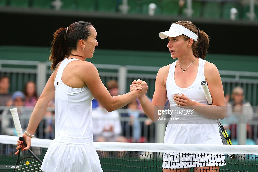 Jelena Jankovic of Serbia shakes hands at the net with Johanna Konta of Great Britain after their Ladies' Singles first round match on day one of the Wimbledon Lawn Tennis Championships at the All England Lawn Tennis and Croquet Club on June 24, 2013 in London, England.