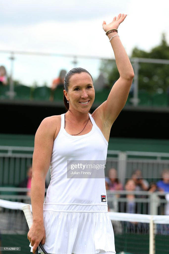 Jelena Jankovic of Serbia waves to the crowd as she celebrates match point during her Ladies' Singles first round match against Johanna Konta of Great Britain on day one of the Wimbledon Lawn Tennis Championships at the All England Lawn Tennis and Croquet Club on June 24, 2013 in London, England.
