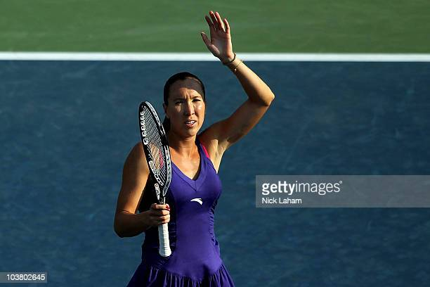Jelena Jankovic of Serbia waves to the waves as she celebrates winning her match against Mirjana Lucic of Croatia during the Women's singles on day...