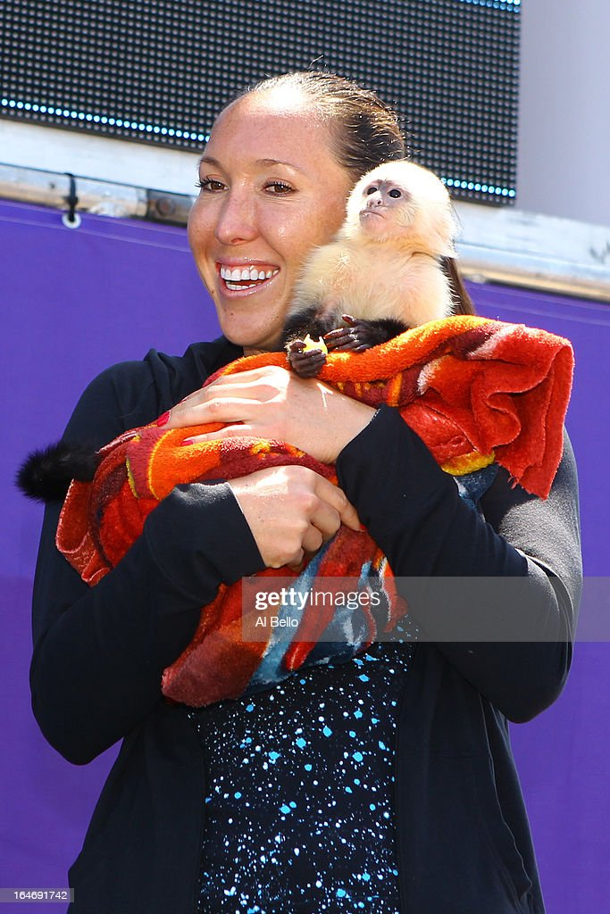 Jelena Janovic of Serbia poses with a monkey during Day 9 of the Sony Open at the Crandon Park Tennis Center on March 26, 2013 in Key Biscayne, Florida.