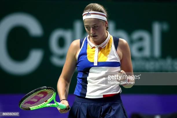 Jelena Ostapenko of Latvia celebrates a point in her singles match against Karolina Pliskova of Czech Republic during day 5 of the BNP Paribas WTA...