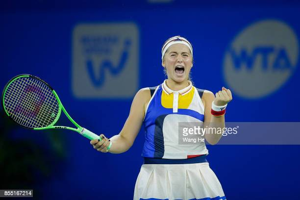 Jelena Ostapenko of Latvia celebrates after defeating Garbine Muguruza of Spain on Day 5 of 2017 Dongfeng Motor Wuhan Open at Optics Valley...