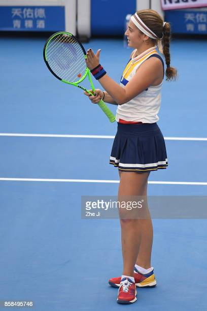 Jelena Ostapenko of Latvia celebrates after winning the Women's Quarter finals match against Sorana Cirstea of Romania on day seven of the 2017 China...