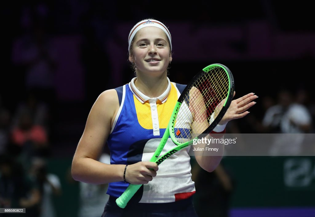 Jelena Ostapenko of Latvia celebrates victory in her singles match against Karolina Pliskova of Czech Republic during day 5 of the BNP Paribas WTA Finals Singapore presented by SC Global at Singapore Sports Hub on October 26, 2017 in Singapore.