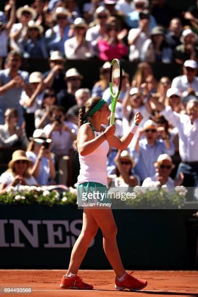Jelena Ostapenko of Latvia celebrates winning the second set during the ladies singles final against Simona Halep of Romania on day fourteen of the...