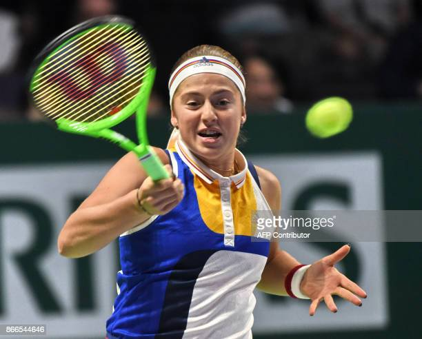 Jelena Ostapenko of Latvia hits a return against Karolina Pliskova of Czech Republic during the WTA Finals tennis tournament in Singapore on October...