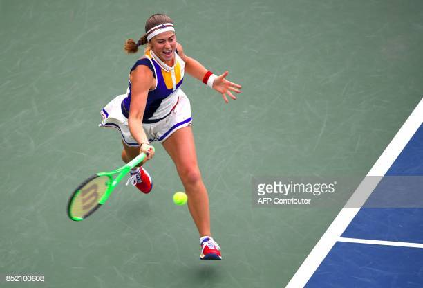 Jelena Ostapenko of Latvia hits a return against Luksika Kumkhum of Thailand during their women's singles semifinal match at the WTA Korea Open...