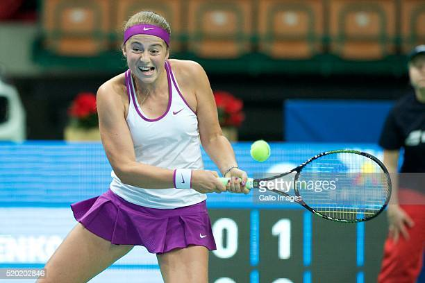 Jelena Ostapenko of Latvia plays a backhand against Camila Giorgi of italy during the WTA Katowice Open first semifinal match on April 9 2016 at...