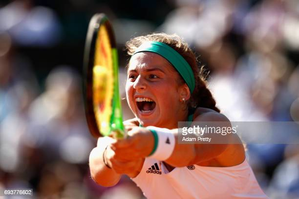 Jelena Ostapenko of Latvia plays a backhand during ladies singles semifinal match against Timea Bacsinszky of Switzerland on day twelve of the 2017...