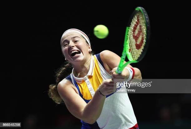 Jelena Ostapenko of Latvia plays a backhand in her singles match against Karolina Pliskova of Czech Republic during day 5 of the BNP Paribas WTA...