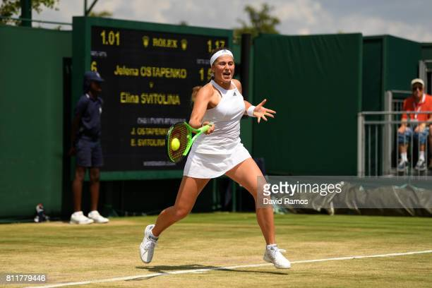 Jelena Ostapenko of Latvia plays a forehand during the Ladies Singles fourth round match against Elina Svitolina of Ukraine on day seven of the...