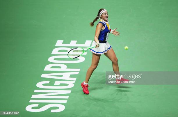 Jelena Ostapenko of Latvia plays a forehand in her singles match against Garbine Muguruza of Spain during day 1 of the BNP Paribas WTA Finals...