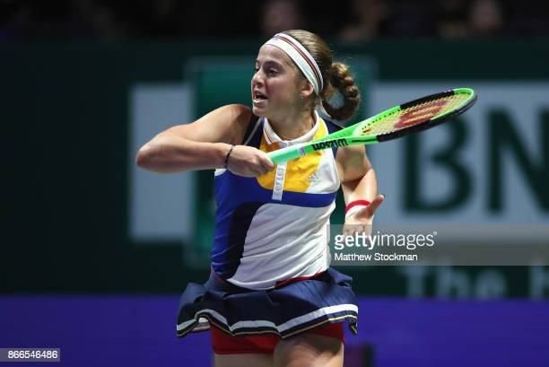 Jelena Ostapenko of Latvia plays a forehand in her singles match against Karolina Pliskova of Czech Republic during day 5 of the BNP Paribas WTA...