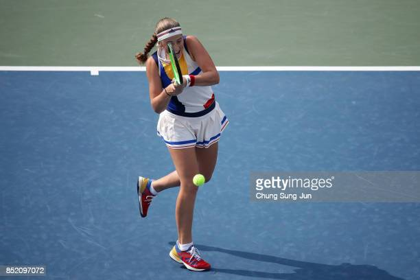 Jelena Ostapenko of Latvia plays a shot against Luksika Kumkhum of Thailand during day six of the KEB Hana Bank Incheon Airport Korea Open at the...