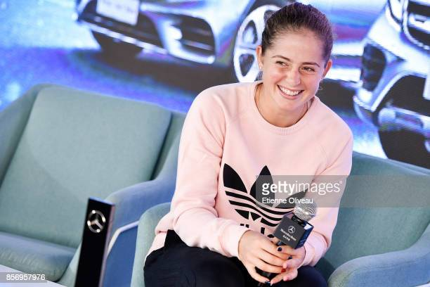 Jelena Ostapenko of Latvia poses for a picture during an event at the MercedesBenz booth on day four of the 2017 China Open at the China National...