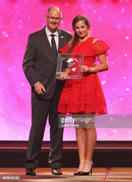 Jelena Ostapenko of Latvia poses with the 2017 WTA Most Improved Player of the Year award with Steve Simon WTA CEO and Chairman during the Official...