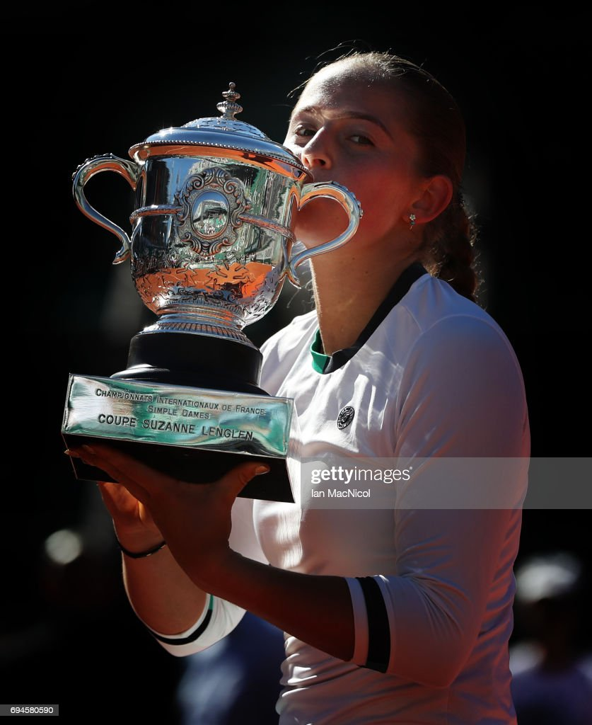 Jelena Ostapenko of Latvia poses with the trophy after her victory during her Women's Single Final match with Simona Halep of Romania, on day fourteen at Roland Garros on June 10, 2017 in Paris, France.
