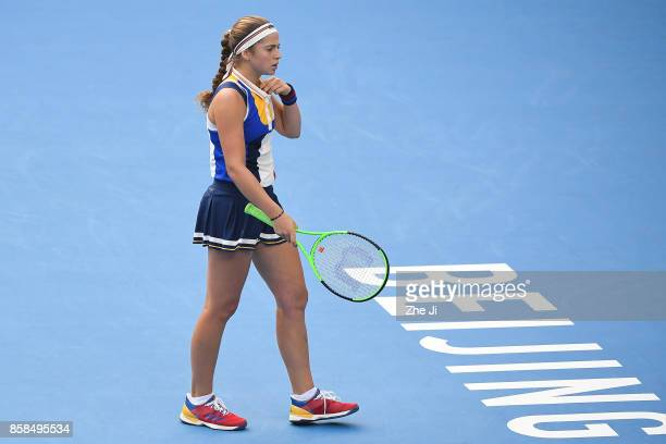 Jelena Ostapenko of Latvia reacts during the Women's Quarter finals match against Sorana Cirstea of Romania on day seven of the 2017 China Open at...