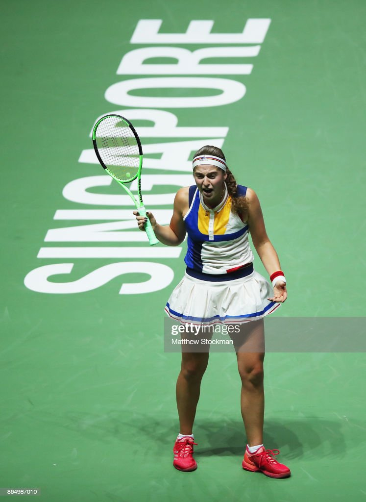 Jelena Ostapenko of Latvia reacts in the singles match against Garbine Muguruza of Spain during day 1 of the BNP Paribas WTA Finals Singapore presented by SC Global at Singapore Sports Hub on October 22, 2017 in Singapore.