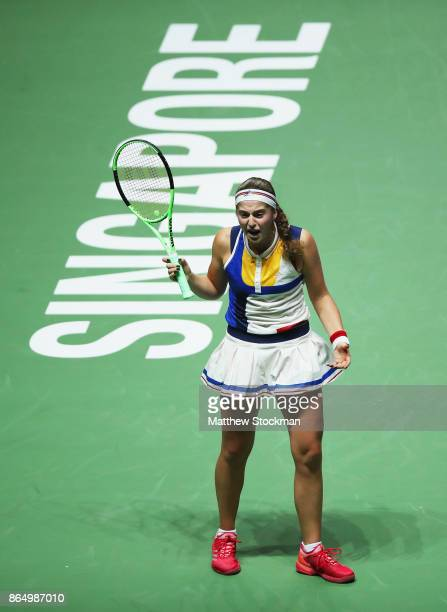 Jelena Ostapenko of Latvia reacts in the singles match against Garbine Muguruza of Spain during day 1 of the BNP Paribas WTA Finals Singapore...