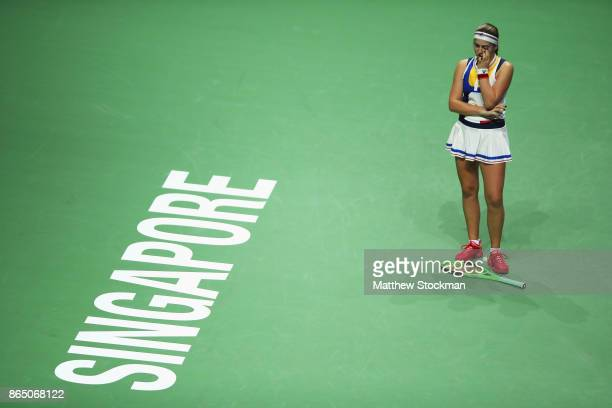 Jelena Ostapenko of Latvia reacts to a lost point while playing Garbine Muguruza of Spain during day 1 of the BNP Paribas WTA Finals Singapore...