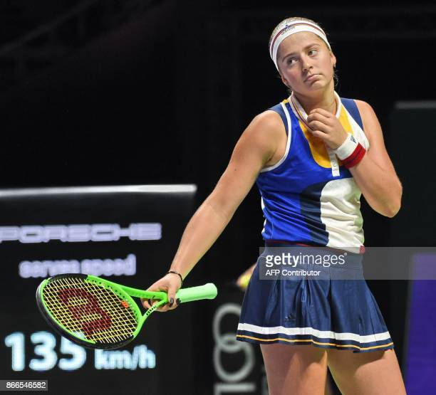 Jelena Ostapenko of Latvia reacts to a point against Karolina Pliskova of Czech Republic during the WTA Finals tennis tournament in Singapore on...
