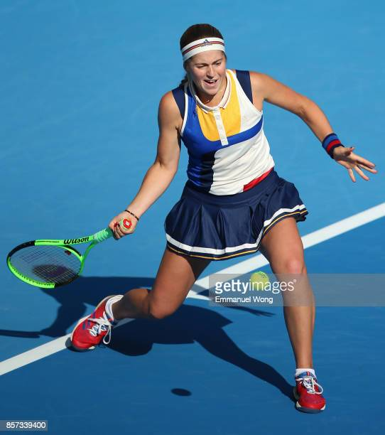 Jelena Ostapenko of Latvia returns a shot against Samantha Stosur of Australia on day five of the 2017 China Open at the China National Tennis Centre...
