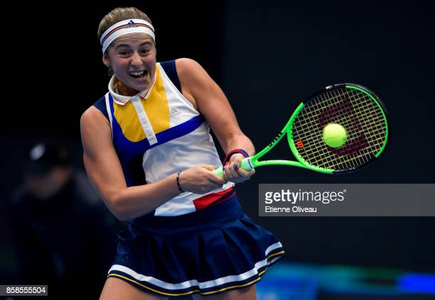 Jelena Ostapenko of Latvia returns a shot against Simona Halep of Romania during her Women's single semifinal match on day eight of the 2017 China...