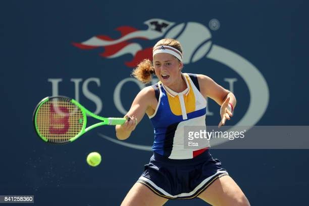 Jelena Ostapenko of Latvia returns a shot against Sorana Cirstea of Romania during their second round Women's Singles match on Day Four of the 2017...