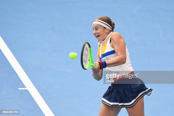 Jelena Ostapenko of Latvia returns a shot against Sorana Cirstea of Romania during the Women's Quarter finals match on day seven of the 2017 China...