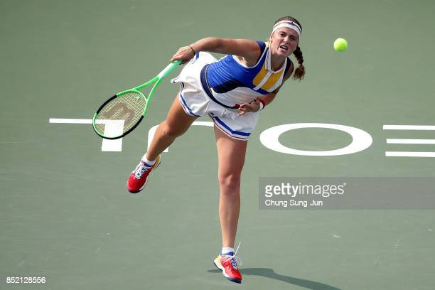 Jelena Ostapenko of Latvia serves against Luksika Kumkhum of Thailand during day six of the KEB Hana Bank Incheon Airport Korea Open at the Olympic...