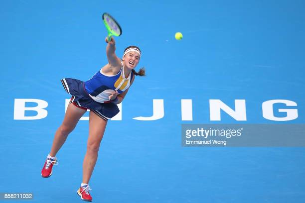 Jelena Ostapenko of Latvia serves against Sorana Cirstea of Romania during the Women's Quarter finals match on day seven of the 2017 China Open at...