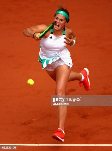 Jelena Ostapenko of Latvia serves during ladies singles Quarter Finals match against Caroline Wozniacki of Denmark on day ten of the 2017 French Open...