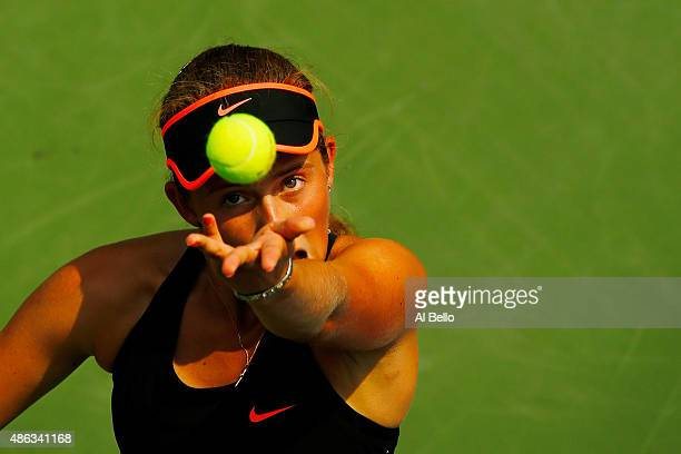 Jelena Ostapenko of Latvia serves to Sara Errani of Italy during their Women's Singles Second Round match on Day Four of the 2015 US Open at the USTA...