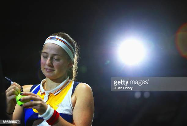 Jelena Ostapenko of Latvia signs autographs after her singles match against Karolina Pliskova of Czech Republic during day 5 of the BNP Paribas WTA...