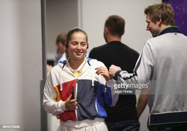 Jelena Ostapenko of Latvia smiles backstage before her singles match against Garbine Muguruza of Spain during day 1 of the BNP Paribas WTA Finals...